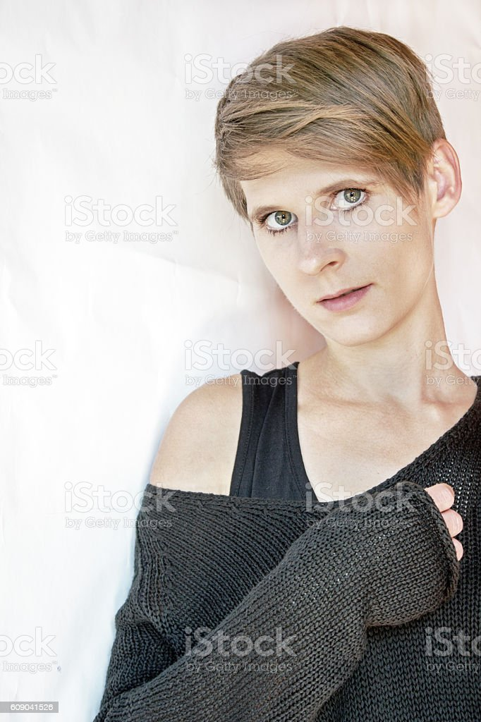 Portrait of a young woman in black knitted sweater stock photo