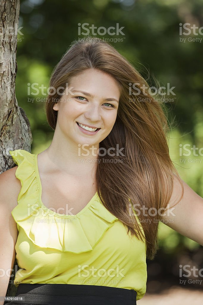 Portrait of a Young Woman in Green royalty-free stock photo