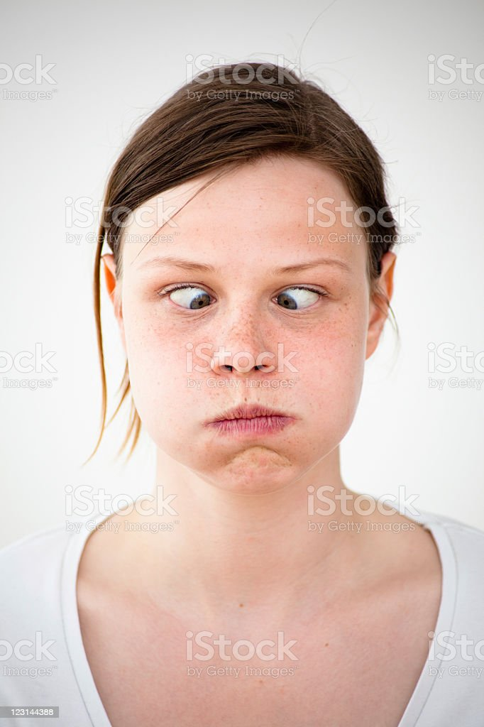 Portrait of a young woman making squinting stock photo
