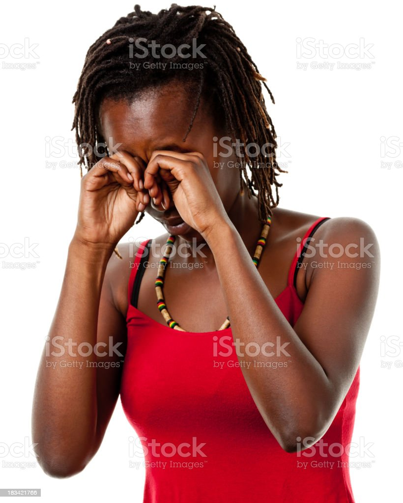 Portrait of a young woman rubbing her eyes stock photo