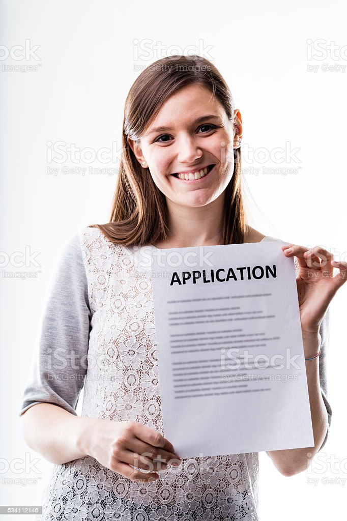 portrait of a young woman with an application stock photo