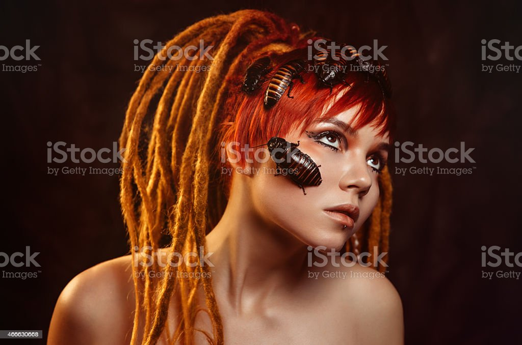 Portrait of a young woman with cockroaches stock photo