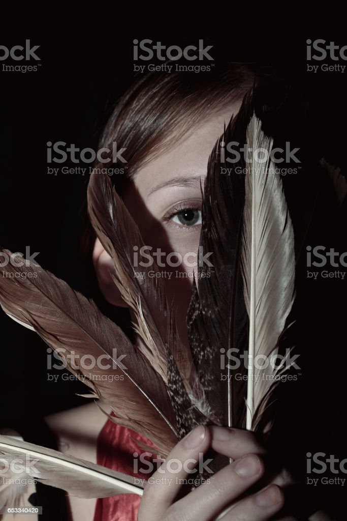 Portrait of a young woman with feathers stock photo