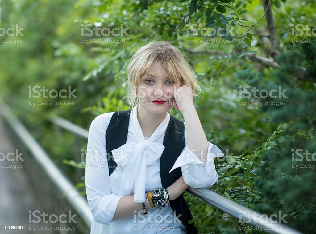 Portrait of a young woman with green background. stock photo