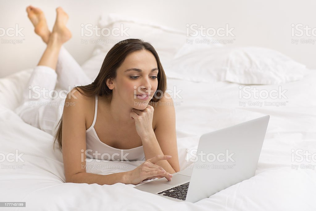 Portrait of a young woman with her computer royalty-free stock photo