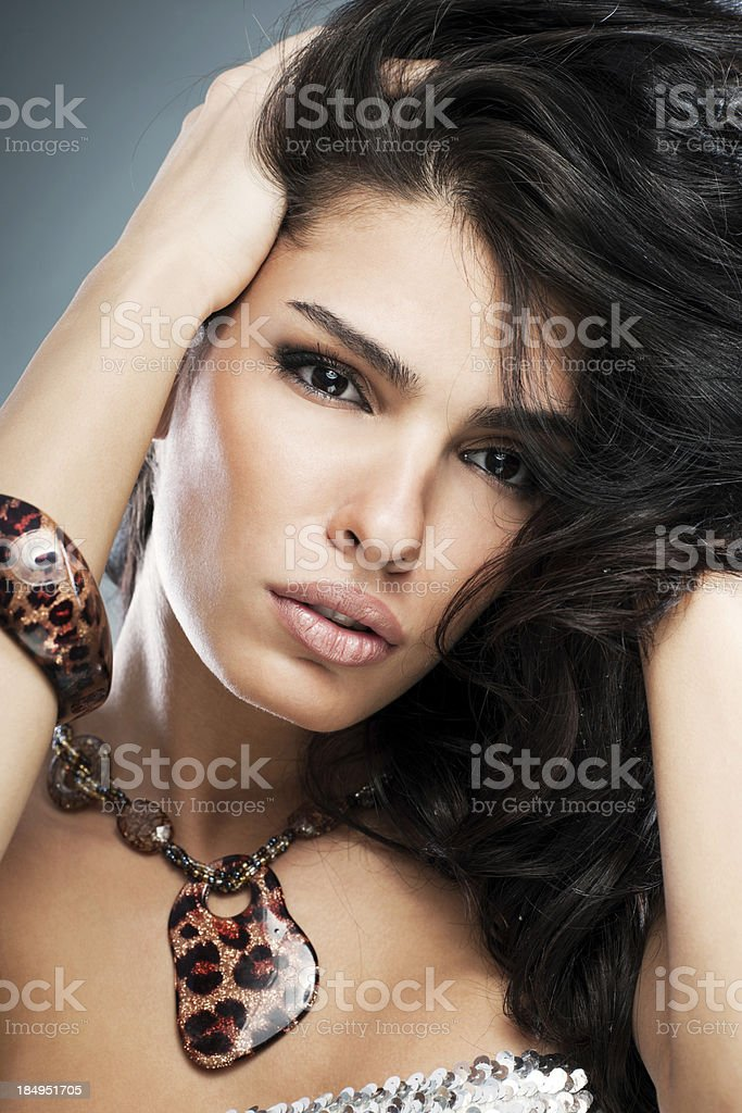 Portrait of a young woman with jewelry. royalty-free stock photo