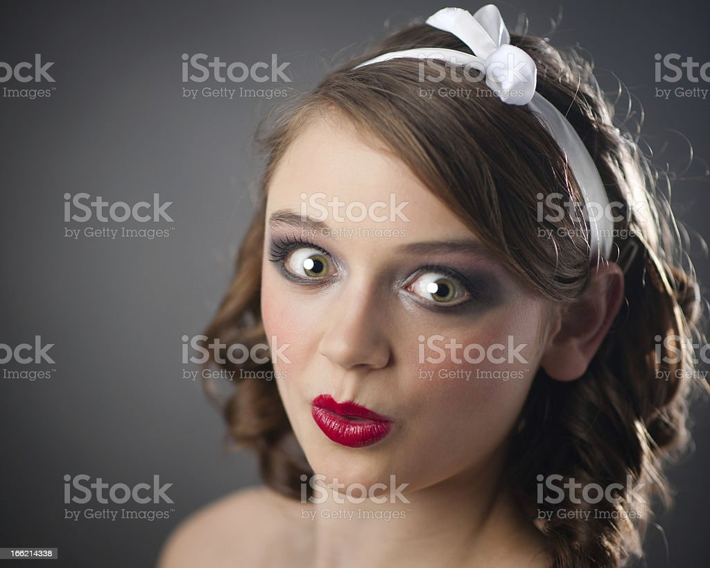 Portrait of a young woman with shocked expression stock photo