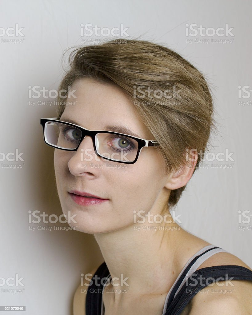 Short hairstyles with glasses - Portrait Of A Young Woman With Short Hair And Glasses Royalty Free Stock Photo