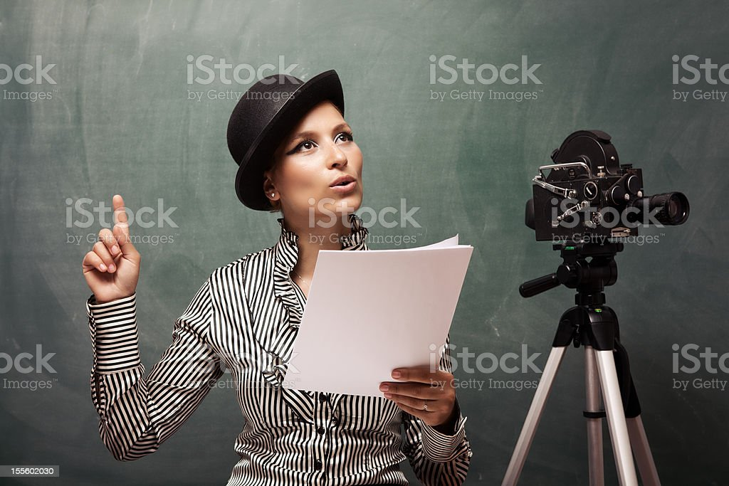Portrait of actress reading script behind camera stock photo
