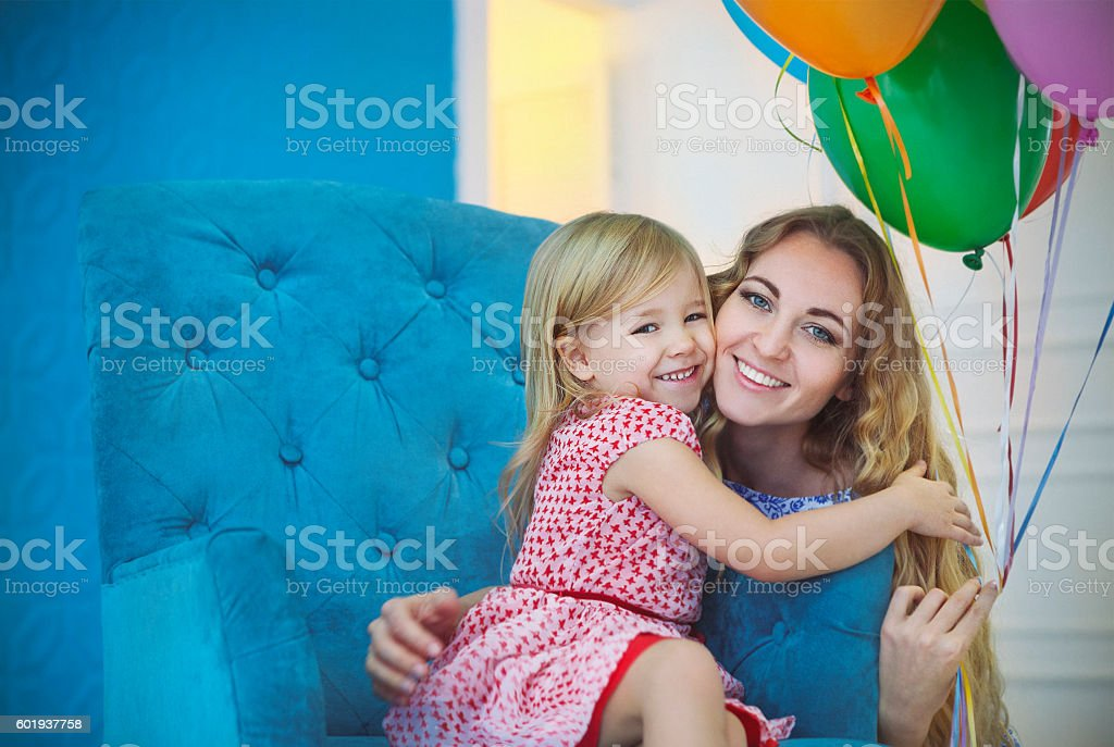 Portrait of adorable little baby girl celebrating birthday with stock photo