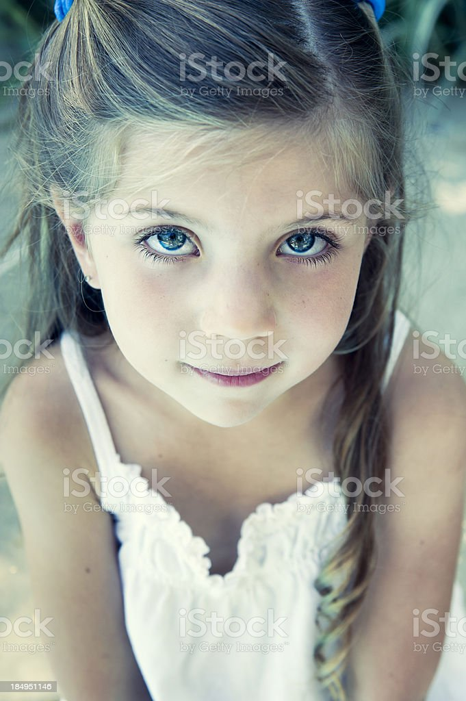 Portrait of adorable little girl by the pool. royalty-free stock photo