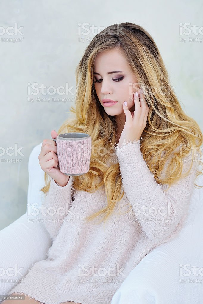 Portrait of adorable woman holding a cup of hot tea stock photo