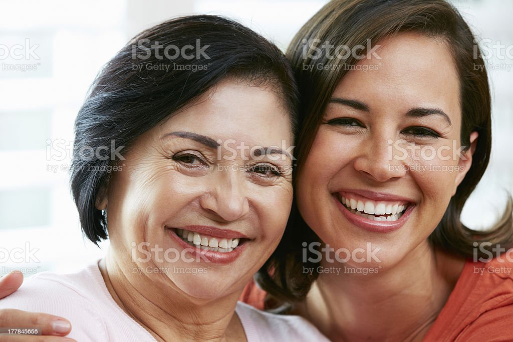 Portrait Of Adult Daughter With Mother At Home stock photo