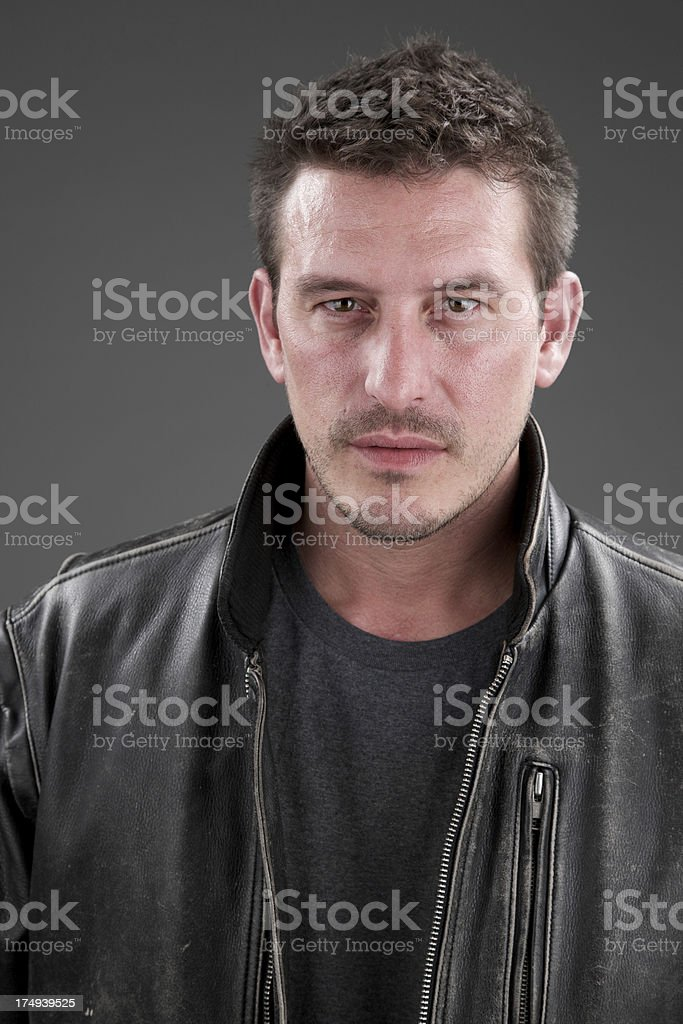 Portrait of adult male with serious expression royalty-free stock photo