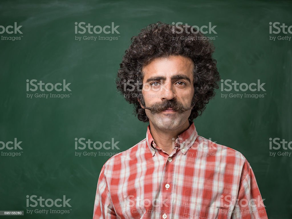 Portrait Of Adult Man With Big Handlebar Mustache stock photo