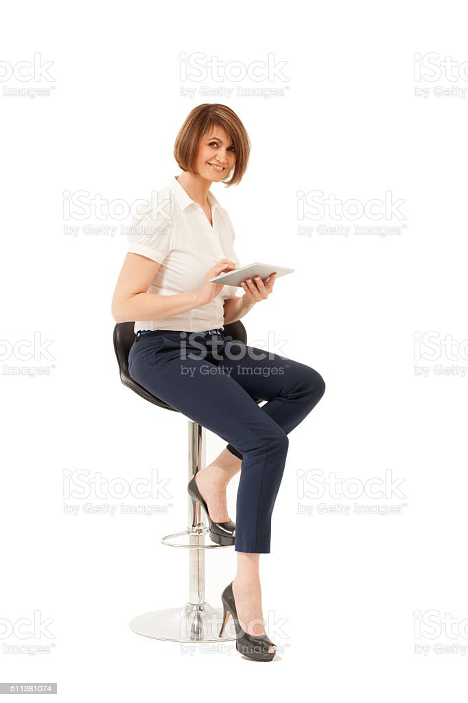 Portrait of adult woman with tablet looking at camera stock photo