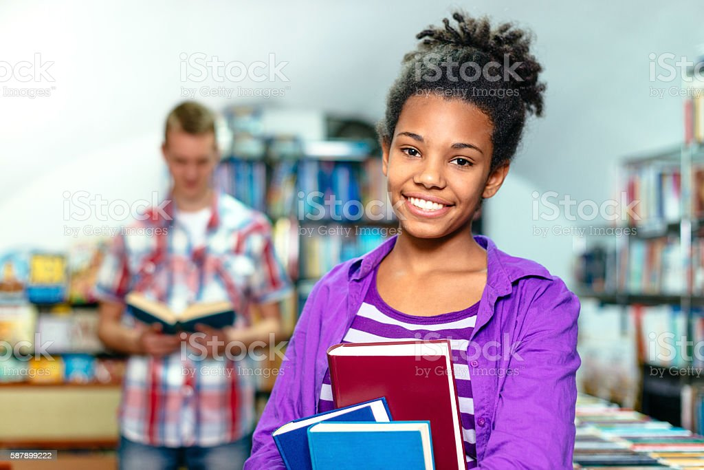 Portrait of Afrcan-American teenager in library stock photo