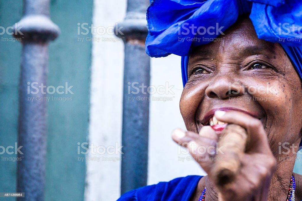 Portrait of african cuban woman smoking cigar in Havana, Cuba stock photo