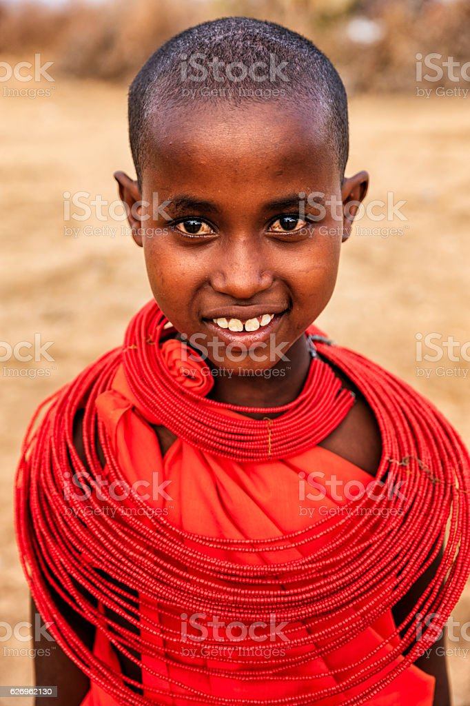 Portrait of African little girl on savanna, East Africa stock photo