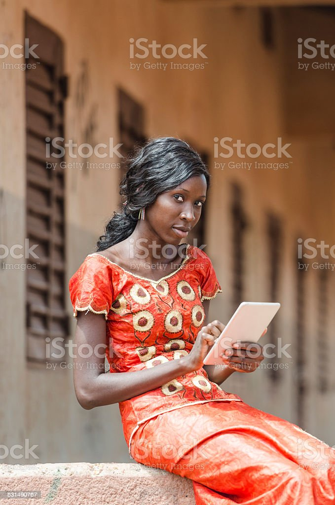 Portrait of African School Girl Playing With Her Tablet Computer stock photo