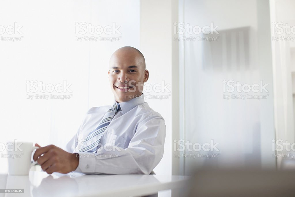 Portrait of African-American businessman having coffee royalty-free stock photo