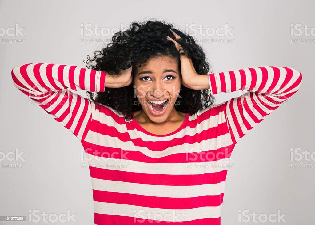 Portrait of afro american woman screaming stock photo