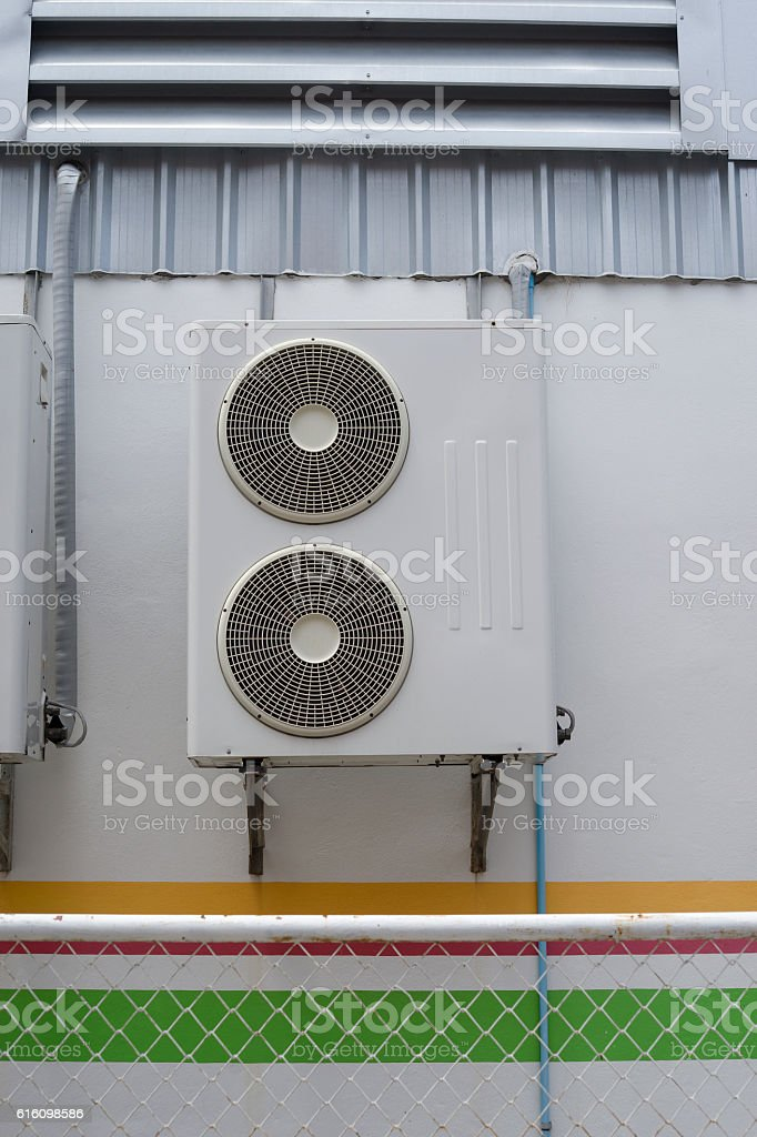 Portrait of air conditioner units on wall outside building stock photo