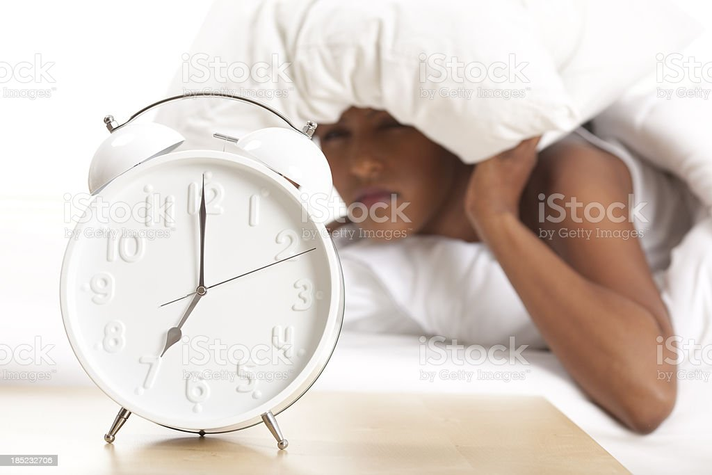 Portrait of alarm clock and upset woman in the background royalty-free stock photo