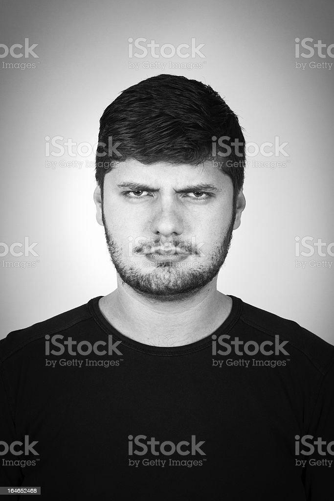 Portrait Of Am Young Angry Man Frowning stock photo