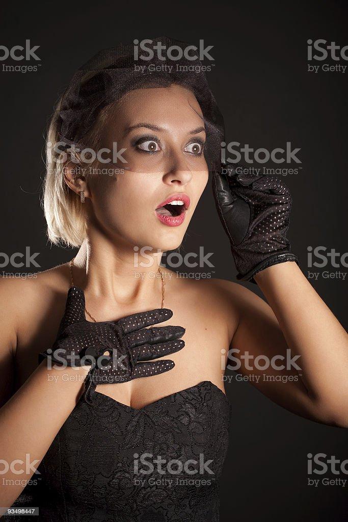 Portrait of amazed retro-style woman in black dress, veill royalty-free stock photo