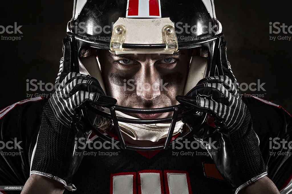 Portrait of American football player in jersey and helmet stock photo