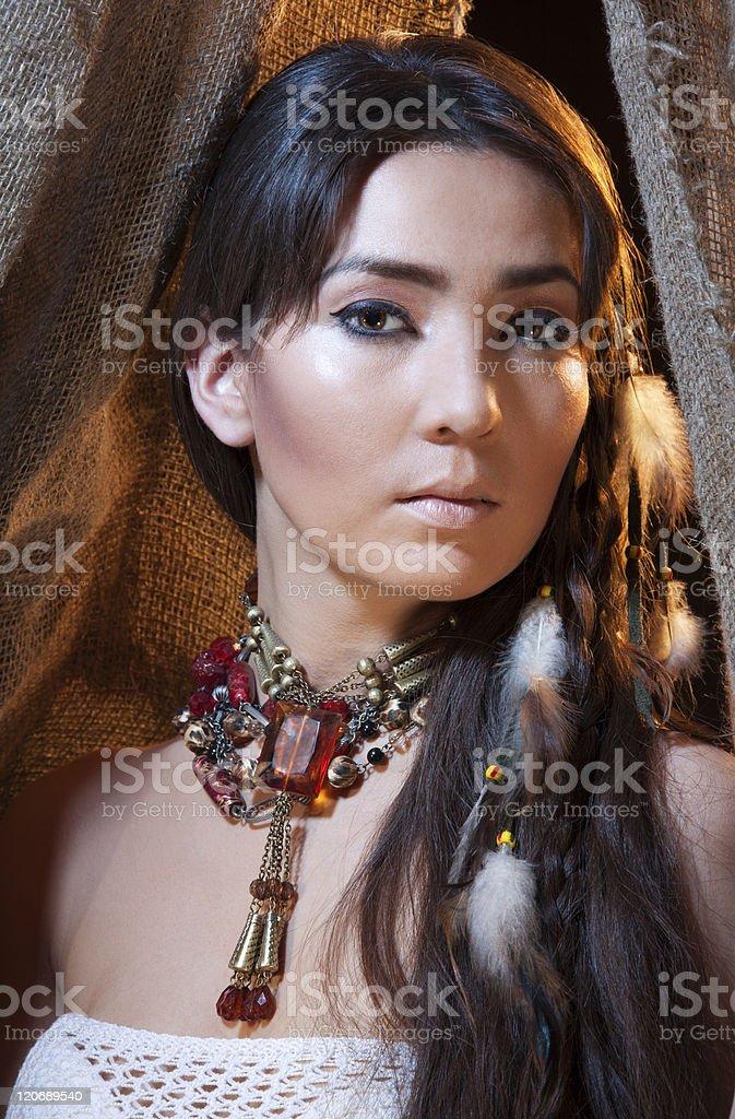 Portrait of American Indian female looking from tent stock photo