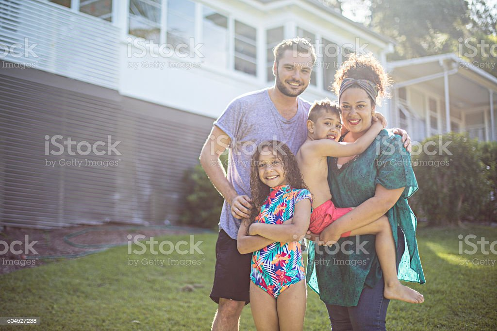 Portrait of an aboriginal family at home stock photo