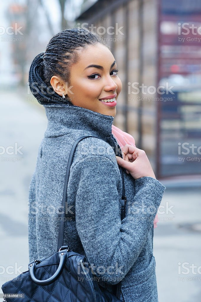 Portrait of an adorable young mixed race woman stock photo