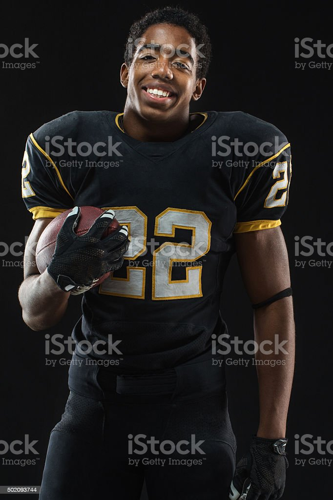 Portrait of an African American football player. stock photo