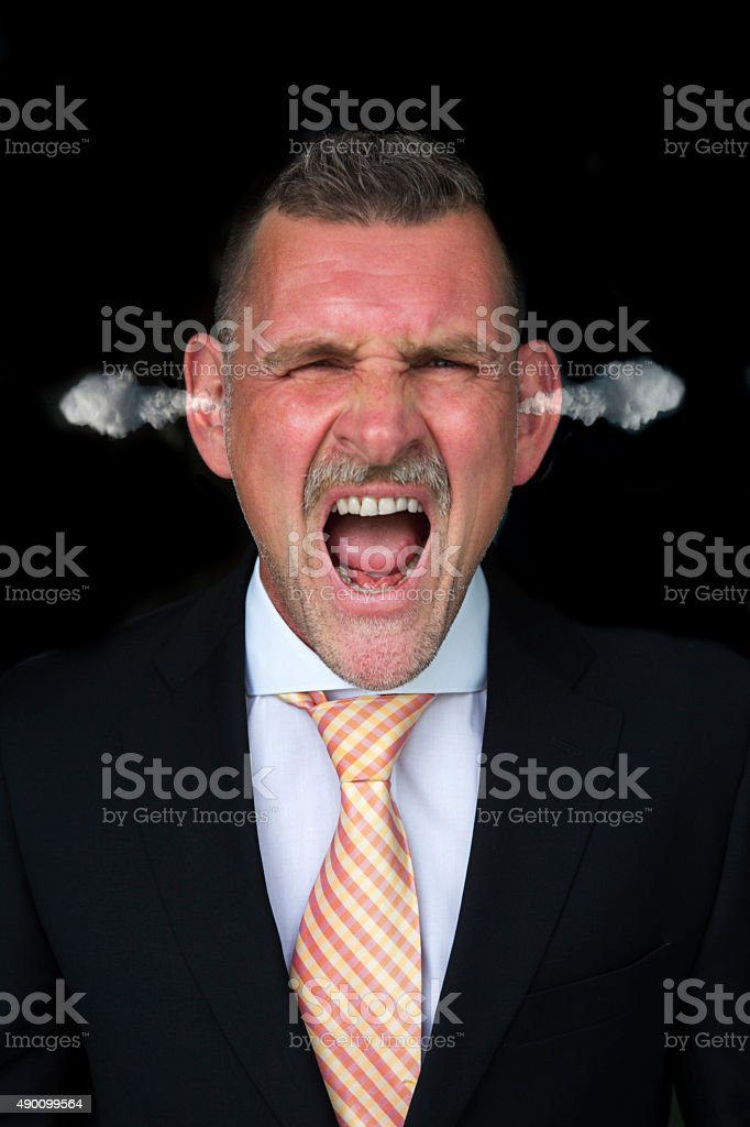 Portrait of an angry businessman stock photo