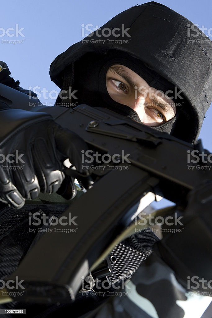 Portrait of an armed soldier in full combat ammunition royalty-free stock photo