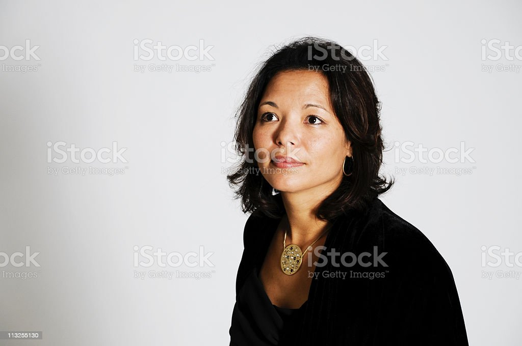 Portrait of an Asian Woman Looking Up stock photo