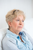 Portrait of an attractive elegant senior woman relaxing