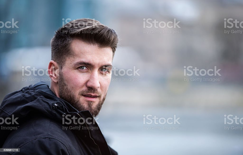 Portrait of an attractive man with a beard stock photo