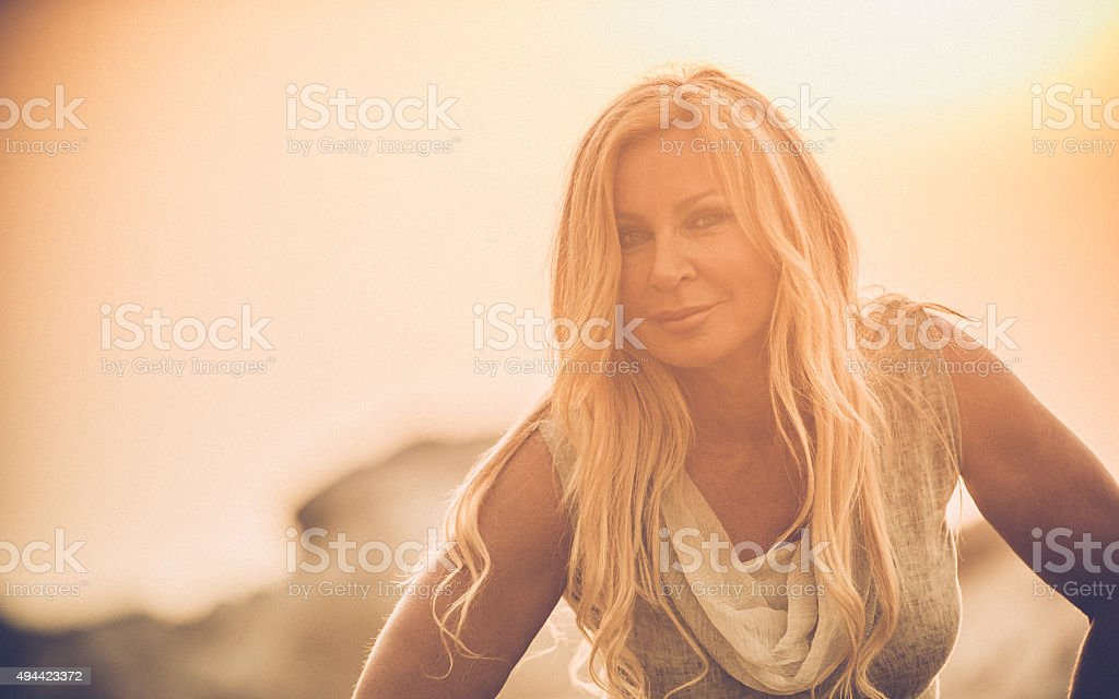 Portrait of an Attractive Mature Woman In Summer Dress stock photo