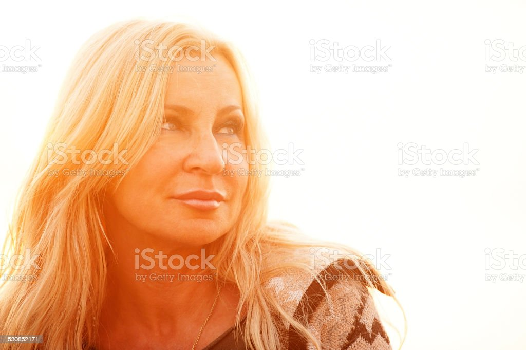Portrait of an Attractive Mature Woman In Woolen Clothings stock photo