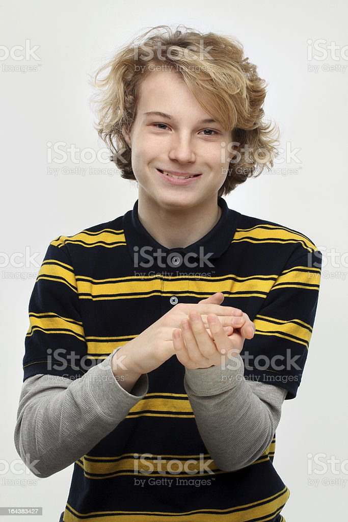 Portrait of an attractive teen clapping hands royalty-free stock photo