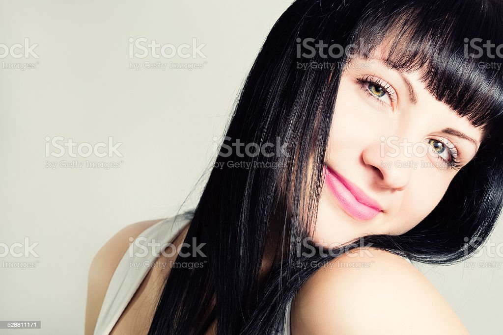 Portrait of an attractive young woman with beautiful hair. stock photo
