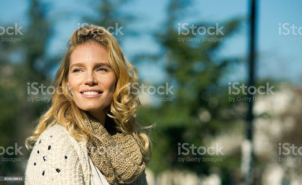Portrait of an beautiful smiling woman stock photo