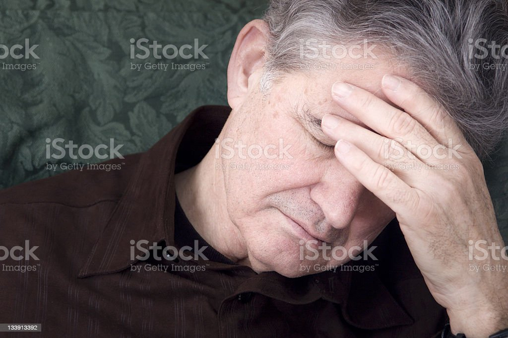 Portrait of an elderly man getting a headache stock photo