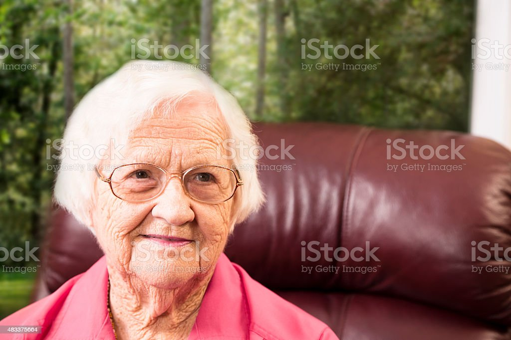 Portrait of an elderly woman at home. Assisted living. stock photo