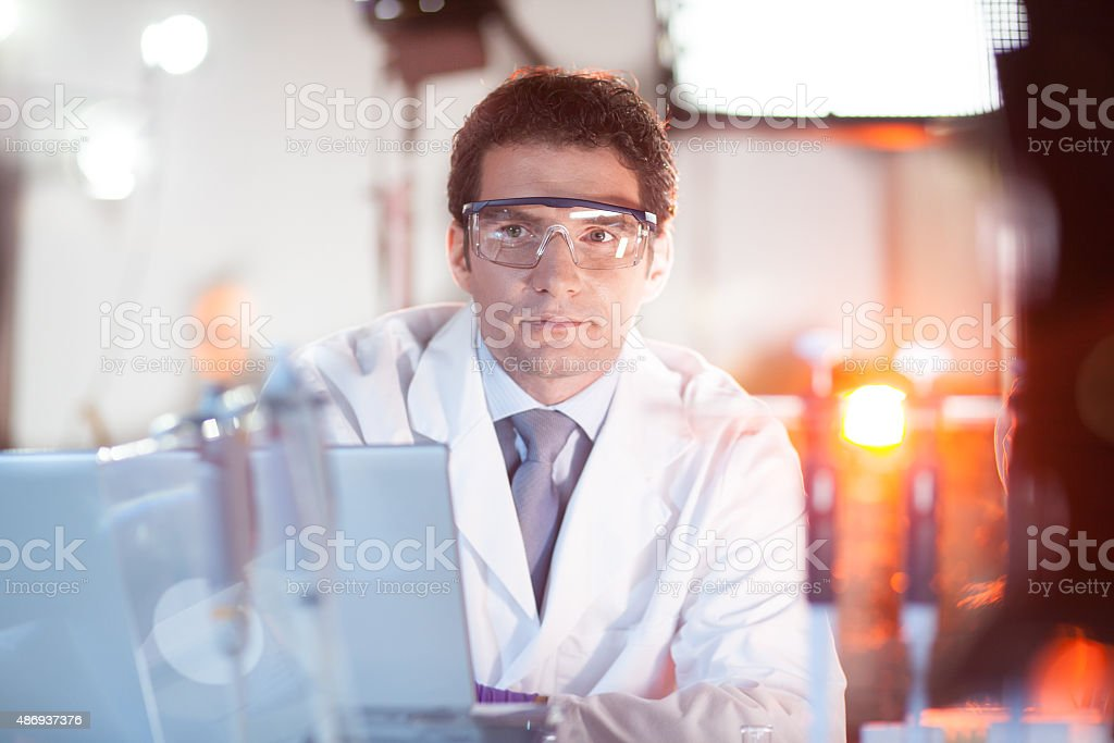 Portrait of an engineer in his working environment. stock photo