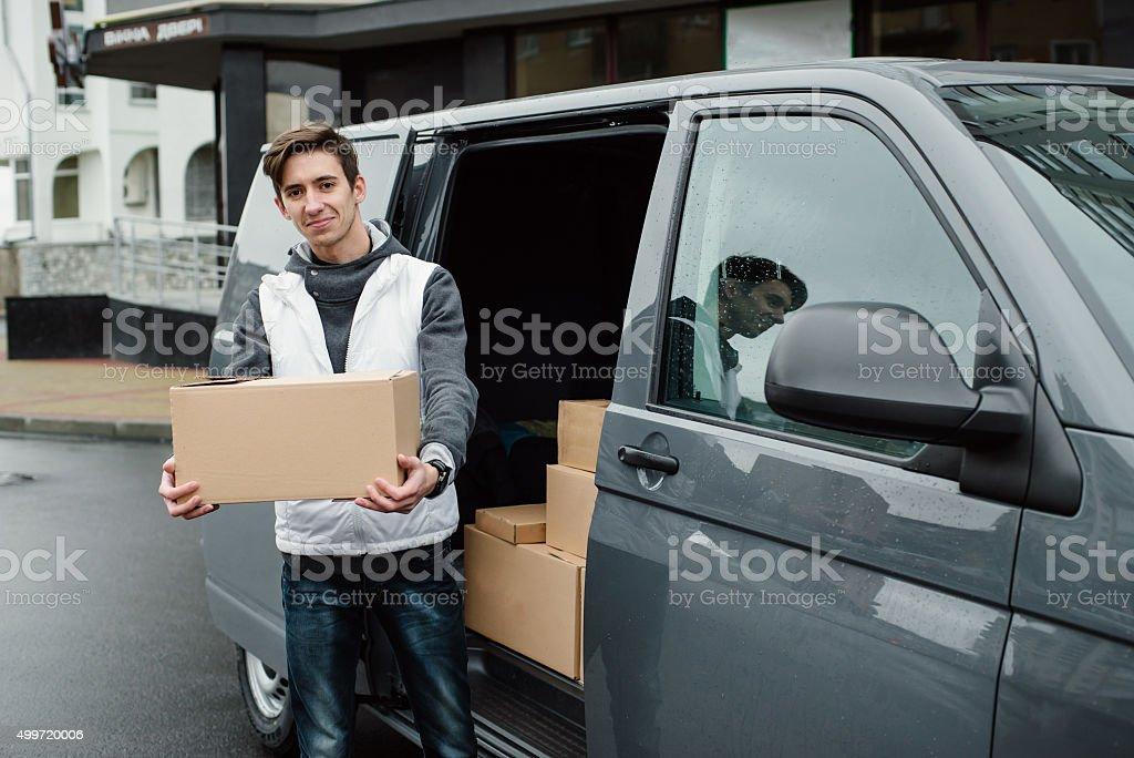 Portrait of an handsome happy deliverer stock photo