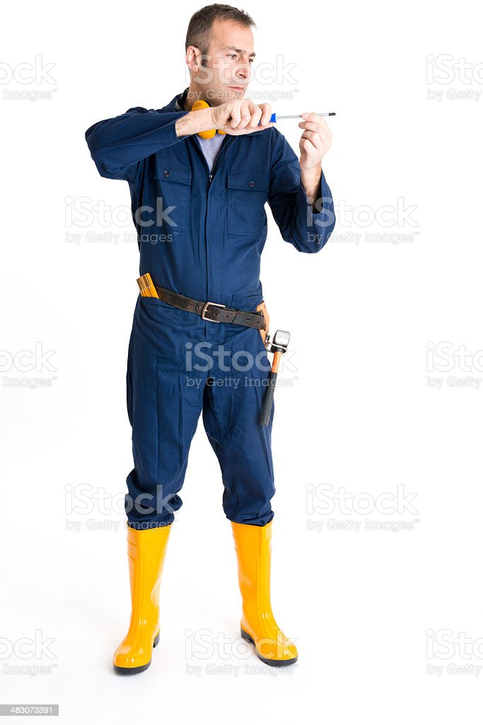 Portrait of an handsome Worker using a screwdriver stock photo